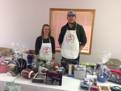 FSB Employees, Tarin and Bryce volunteering at the Christmas Bureau Store.
