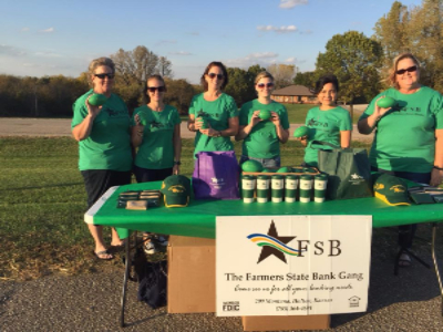 FSB Staff tailgating at Jackson Heights football game.