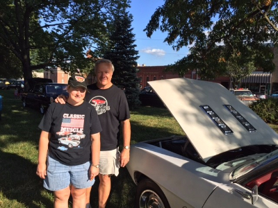 Gary and Kathy standing by classic car at Cruise Night!